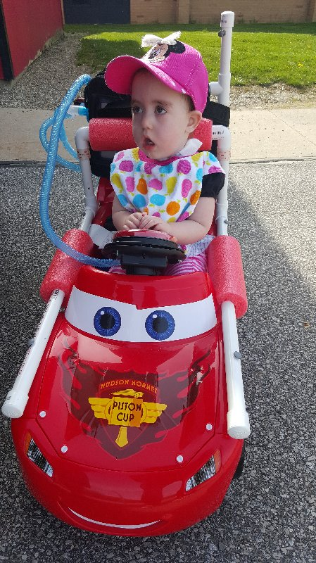 Child in Adapted Ride-On Car