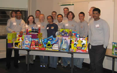 A corporate team poses with the toys they adapted